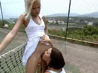 Lesbo tennis players lick on court